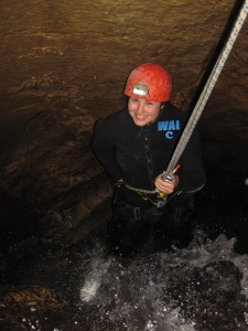 Abseiling in a cave
