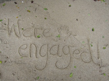 Engagement announcement in the sand